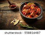 pot of hungarian goulash on... | Shutterstock . vector #558816487