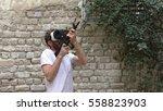 a man plays virtual augmented... | Shutterstock . vector #558823903