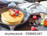 home made pancakes with berries ... | Shutterstock . vector #558885187