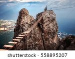 suspension bridge on the mount... | Shutterstock . vector #558895207