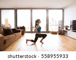 young woman exercising at home  ... | Shutterstock . vector #558955933