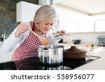senior woman in the kitchen... | Shutterstock . vector #558956077