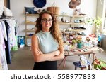 Small photo of Young female business owner in a clothes shop, portrait