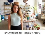 female sales assistant standing ... | Shutterstock . vector #558977893