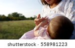 portrait of young mother in a... | Shutterstock . vector #558981223