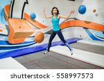 young woman sportsman jumping... | Shutterstock . vector #558997573