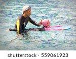 little girl study in swimming... | Shutterstock . vector #559061923