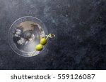 martini cocktail on dark stone... | Shutterstock . vector #559126087