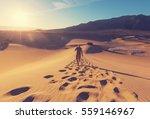 hiker in sand desert. sunrise... | Shutterstock . vector #559146967