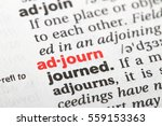 Small photo of Closeup of English dictionary page with word adjourn.