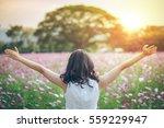 girl enjoying nature in meadow. ... | Shutterstock . vector #559229947