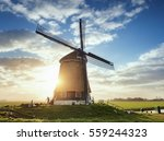 Windmill And Silhouette Of A...