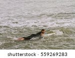 man swims with a board on the... | Shutterstock . vector #559269283