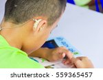 asian boy have a hearing aids. | Shutterstock . vector #559365457