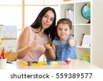 mother and her child daughter... | Shutterstock . vector #559389577