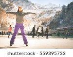 latin girl ice skating outdoor... | Shutterstock . vector #559395733