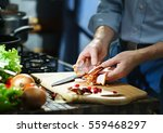 chef with pieces of the bacon... | Shutterstock . vector #559468297