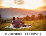 happy oving couple sitting on a ... | Shutterstock . vector #559509043