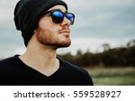 handsome cool young man with... | Shutterstock . vector #559528927