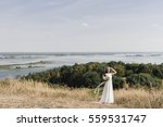 the bride in a white dress ... | Shutterstock . vector #559531747