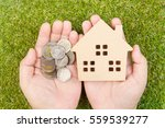 man's hand holding wooden house ... | Shutterstock . vector #559539277