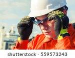 orange robe engineer is wearing ...   Shutterstock . vector #559573243