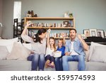 smiling family with arms raised ... | Shutterstock . vector #559574593