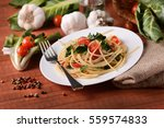 spaghetti with chard and tomato ... | Shutterstock . vector #559574833
