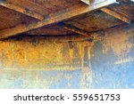 Small photo of Age-related changes in the metal. Corrosion. Destruction. The wall of the shed. Texture.