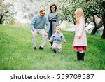 happy family with two children... | Shutterstock . vector #559709587