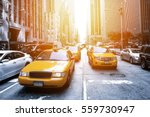 yellow taxi in a black and... | Shutterstock . vector #559730947