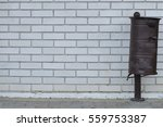 Brown Rusty Dustbin In Front O...