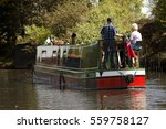 Aged Couple On Narrow Boat In...