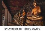yellow golden buddha at wat... | Shutterstock . vector #559760293