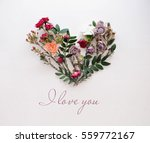 heart symbol made of flowers... | Shutterstock . vector #559772167