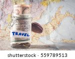 jar with money on used map.... | Shutterstock . vector #559789513