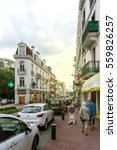 Small photo of Aix-les-Bains, France - Sep 4, 2015: Rue Albert 1st incentral Aix-Les-Bains with pedestrians walking on a calm summer day on the shoping street with restaurnats and drug store