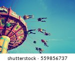 a swinging fair ride at dusk... | Shutterstock . vector #559856737