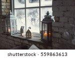 candles on a windowsill.... | Shutterstock . vector #559863613