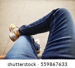 a hipster sitting downtown with ... | Shutterstock . vector #559867633
