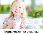 cute little girl drinking fresh ... | Shutterstock . vector #559903783