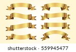 set of golden ribbons on beige... | Shutterstock .eps vector #559945477