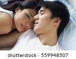 couple lying in bed  woman... | Shutterstock . vector #559948507