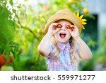 adorable little girl wearing... | Shutterstock . vector #559971277