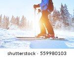 skiing downhill  skier in... | Shutterstock . vector #559980103