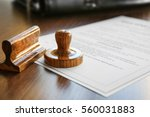 modern notarial stamp on old... | Shutterstock . vector #560031883