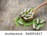 herbal capsules from herbs on... | Shutterstock . vector #560091817