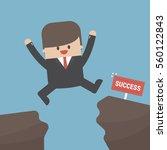 businessman jump through the...   Shutterstock .eps vector #560122843