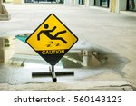 sign warning of caution wet... | Shutterstock . vector #560143123