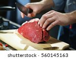cook with a big piece of meat... | Shutterstock . vector #560145163